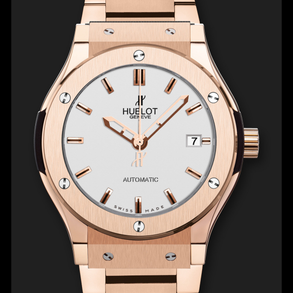 The concise dials have hollowed-out rose gold hands and applied hour markers.
